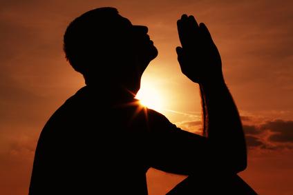 Praying man silhoutte